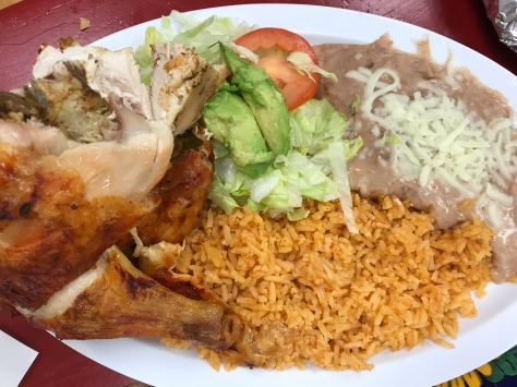 A pollo dish with rice and beans